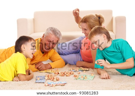 cute family playing on floor on white - stock photo