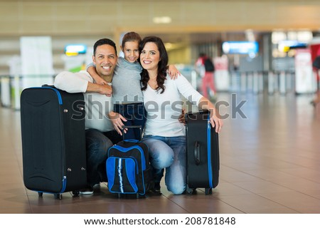 cute family portrait at airport  - stock photo