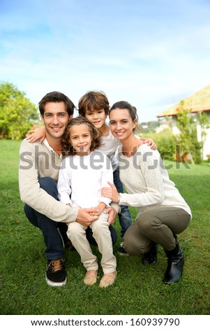 Cute family portrait of 4 people - stock photo