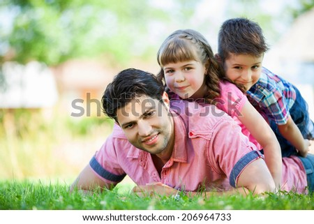 Cute family portrait of 3 people