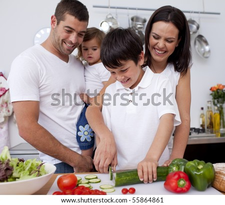 Cute family preparing  lunch together in the kitchen - stock photo