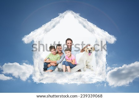 Cute family with pet labrador posing and smiling at camera together against cloudy sky with sunshine - stock photo