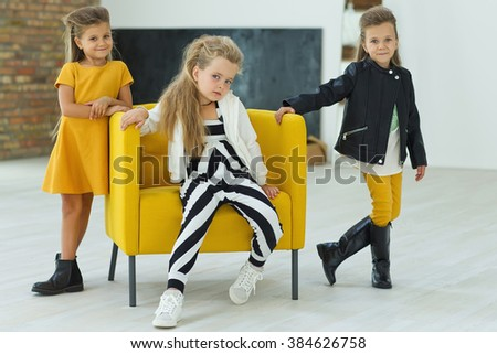 Cute fashion kids are standing together. Fashionable and friendship concept - stock photo