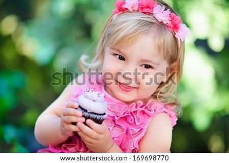 cute fashion little girl eat happy birthday pink cupcake - stock photo