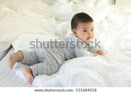 cute fat boy on bed and mattress softness.
