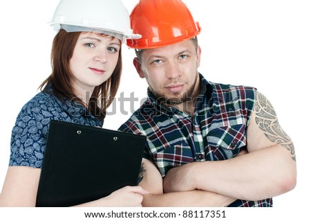 Cute female architect holding a writing pad and muscular manual worker, white background - stock photo