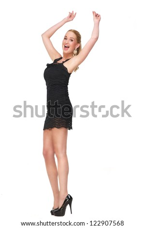 Cute female snapping fingers and with her arms up dancing. She has her arms up and a happy expression on her beautiful face. Full length portrait isolated on white background - stock photo