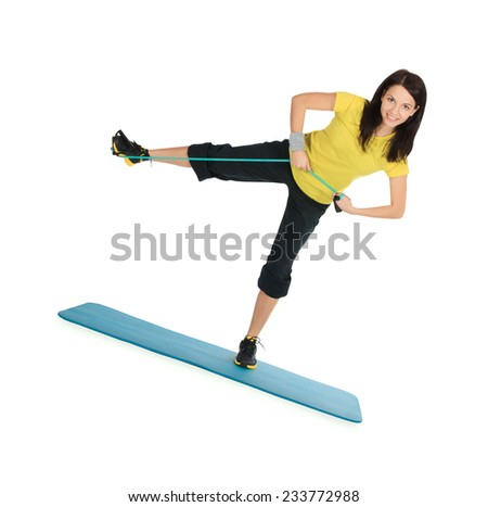 Cute female with expander in stretching fitness exercise - stock photo