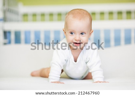 Cute five-month-old baby boy smiling. - stock photo
