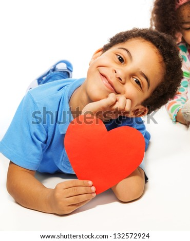 Cute five years old boy with heart symbol with big smile, isolated on white - stock photo