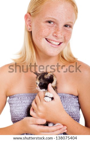 cute freckled teen girl holding a little kitten isolated on white - stock photo