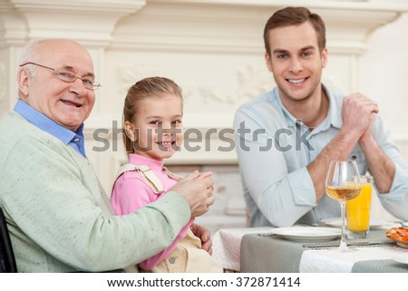 Cute friendly family is dining together - stock photo