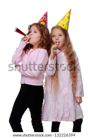 Cute funny little girls at the party on white background