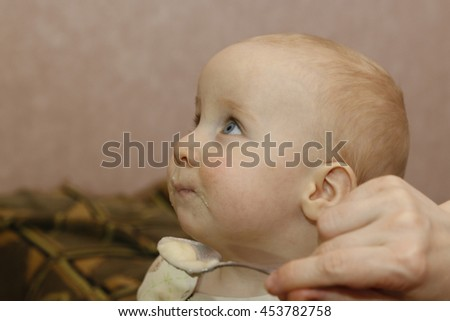 Cute funny young childl in the room - stock photo