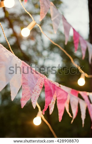 cute garland of colored flags and light bulbs - stock photo