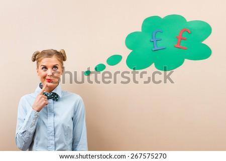 Cute geek girl is thinking about money.Hmmm money... - stock photo