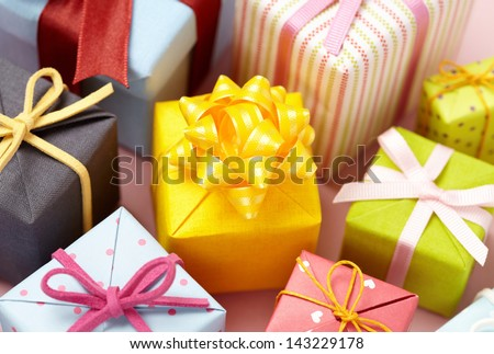 Cute gift boxes on pink background.  Cute Gift boxes with Cute bow. - stock photo
