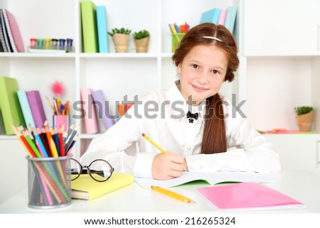 Cute girl at workplace in classroom