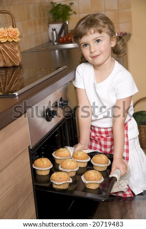 Cute girl baking muffins - stock photo