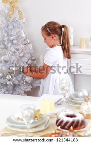 Cute girl decorating Christmas tree - stock photo