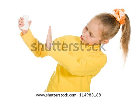 Cute girl denied medication in a bottle on a white background. - stock photo