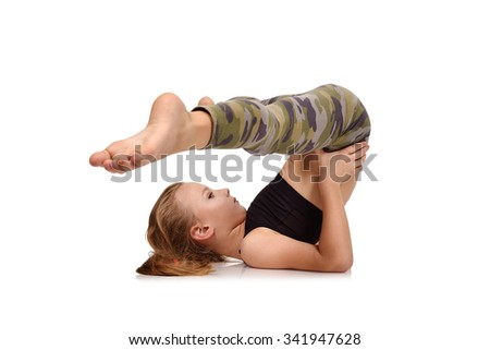 cute girl does exercise on white background