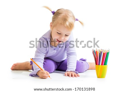 cute girl drawing with colourful pencils - stock photo