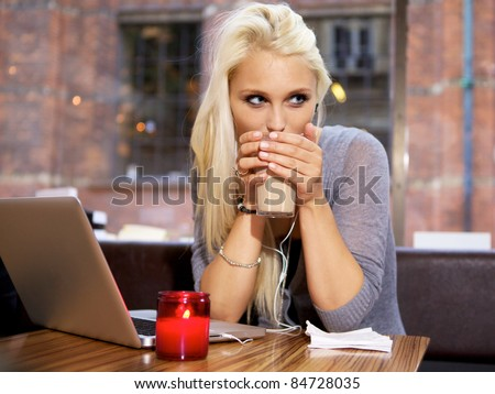Cute girl drinking coffee on a cafe in the city. - stock photo