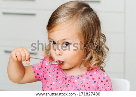 Cute girl eating - stock photo
