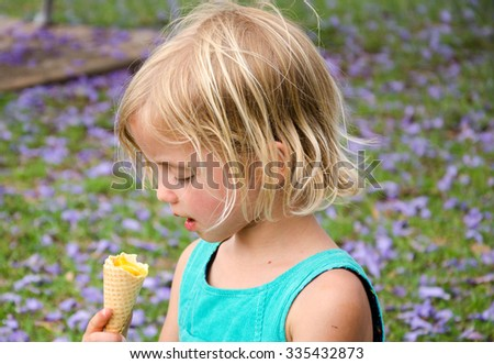 Cute Girl Eating Ice Cream
