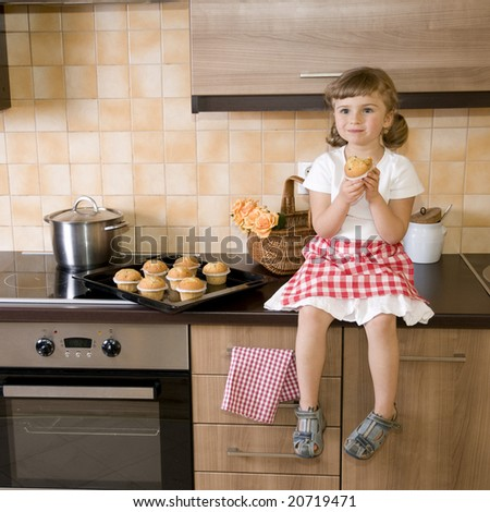 Cute girl eating muffins - stock photo