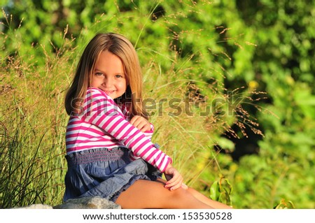cute girl enjoying a sunny day in the park - stock photo