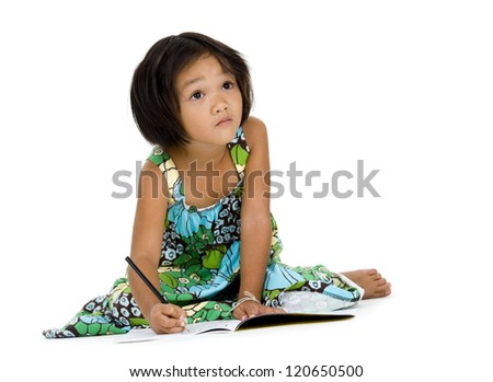 cute girl figuring out what to write, isolated on white background - stock photo