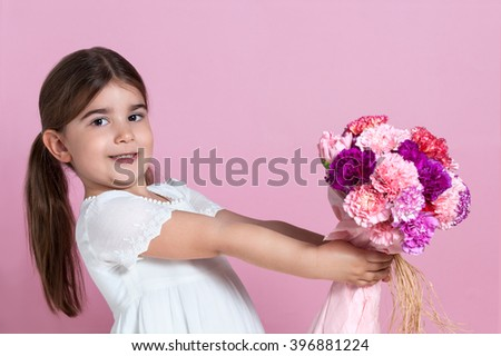 Cute girl giving flowers - stock photo