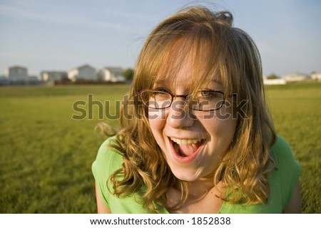Cute girl having a good time in park.