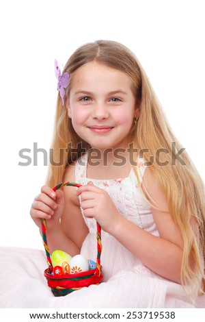 cute girl holding a basket with easter eggs - stock photo