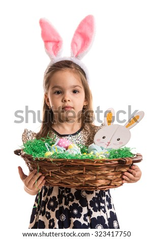 Cute girl holding Easter basket with eggs isolated on white background - stock photo