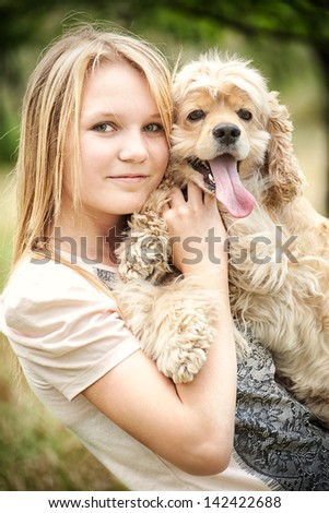 Cute girl holding funny looking dog
