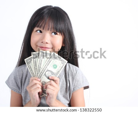 Cute girl holding money - stock photo