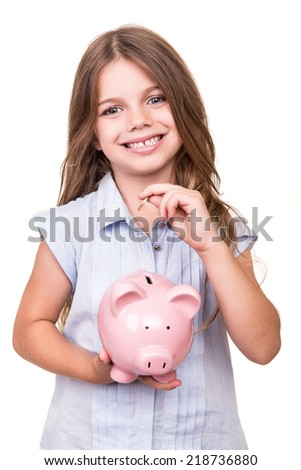 Cute girl holding pink piggy bank