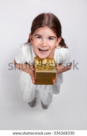 Cute girl holding present box - stock photo