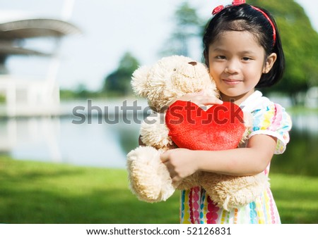 cute girl hug a teddy bear - stock photo