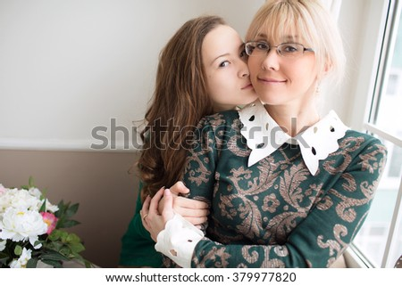 Cute girl hugging her mother. Mother's day. - stock photo