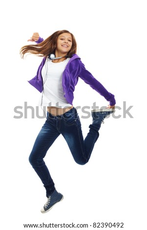 Cute girl in casual clothes jumping in isolation