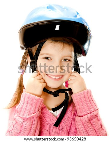 Cute girl in crash helmet on a white background