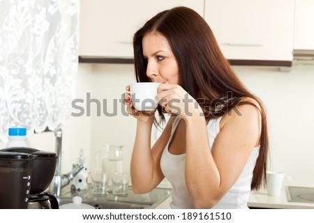 cute girl in pajama drinking coffee.  - stock photo