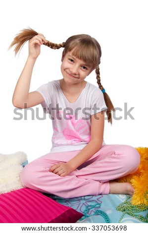 Cute girl in pink pajamas smiling  isolated on white - stock photo