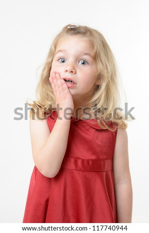 cute girl in red dress with an astonished expression - stock photo