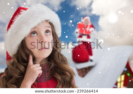 Cute girl in santa hat against blue sky with white clouds - stock photo