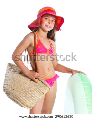 Cute girl in swimsuit holding swimming circle. Isolated on white background - stock photo